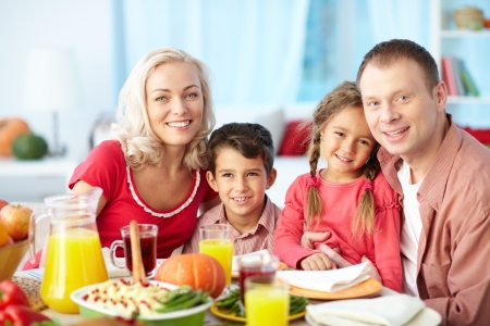 Portrait of happy family sitting at festive table and looking at camera Stock Photo - 15610877
