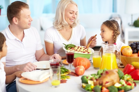 Portrait of happy family sitting at festive table on Thanksgiving Day Stock Photo - 15610640