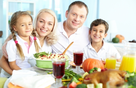 Portrait of happy family sitting at festive table and looking at camera Stock Photo - 15610634