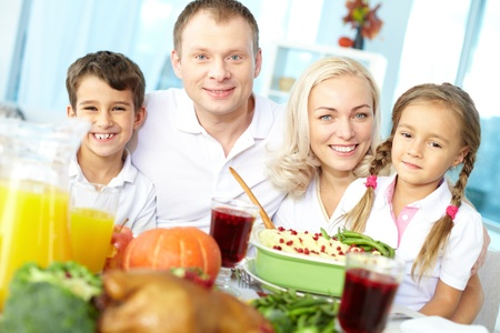 Portrait of happy family sitting at festive table and looking at camera Stock Photo - 15609872