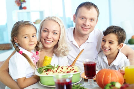 Portrait of happy family sitting at festive table and looking at camera Stock Photo - 15610636