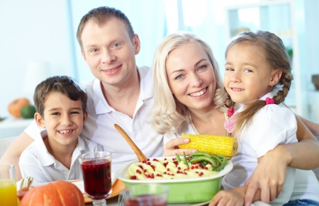 Portrait of happy family sitting at festive table and looking at camera Stock Photo - 15610642