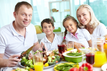 Portrait of happy family sitting at festive table and looking at camera Stock Photo - 15609766