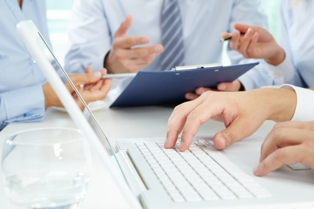 Corporations: Close-up of male hands typing on the laptop keyboard