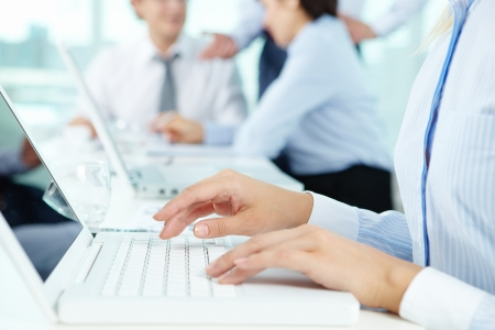programmer: Close-up of female hands typing on the laptop keyboard in working environment Stock Photo
