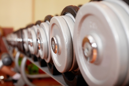 Image of row of barbells  photo