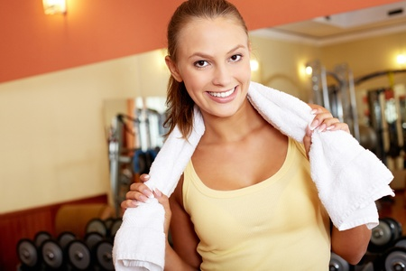 Portrait of pretty girl with towel looking at camera in gym Stock Photo - 15725925