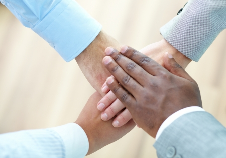 Above angle of pile of hands of business partners Stock Photo - 15751397
