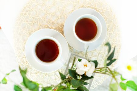 pureness: The above view of two teacups with energetic drink Stock Photo