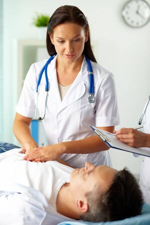 serious doctor: Portrait of confident female doctors during medical treatment of patient in hospital Stock Photo