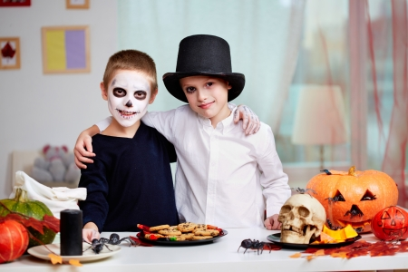 antichrist: Photo of twin eerie boys looking at camera at Halloween table