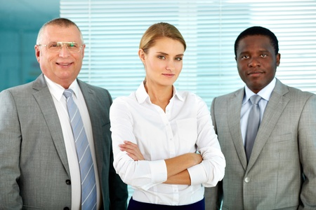 Portrait of three business partners looking at camera with smiles photo