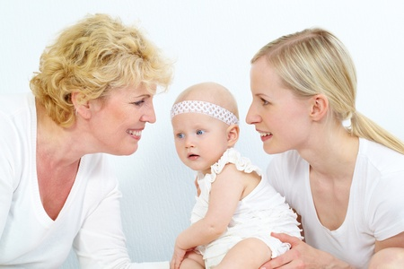 grandmother and children: Portrait of happy grandmother, mother and cute baby girl