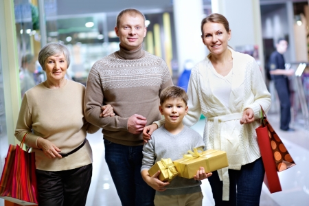 Portrait of happy family during shopping in the mall before Christmas photo