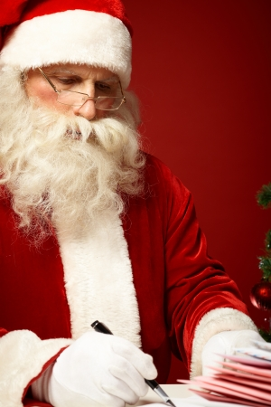 Portrait of Santa Claus answering Christmas letter photo