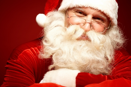 santa cap: Photo of happy Santa Claus in eyeglasses looking at camera