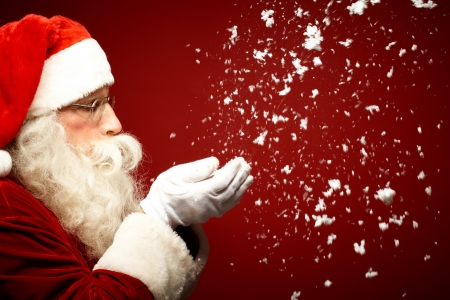 xmass: Photo of Santa Claus blowing snow and looking at it