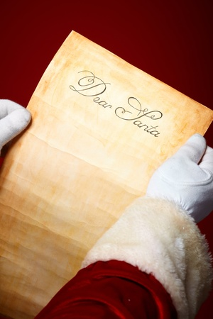 claus: Close-up of Christmas letter in Santa Claus hands Stock Photo