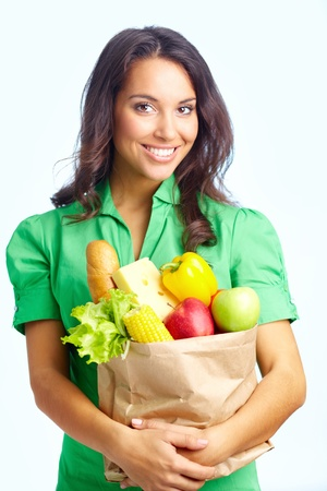 vegs: Portrait of pretty girl with big paper sack full of healthy food in isolation