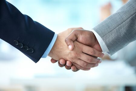 hands joined: Close-up of handshake of business partners