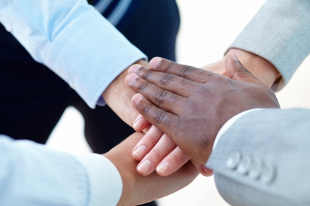 Above angle of pile of hands of business partners Stock Photo - 16103613