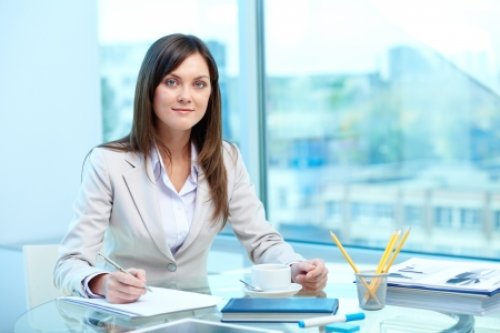 competitive business: Portrait of young female writing proficiency test Stock Photo