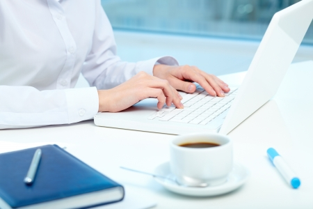 Close-up of female hands typing on laptop Stock Photo - 16103609