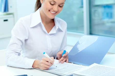 secretary office: Portrait of young female writing proficiency test Stock Photo