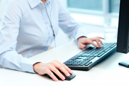 Close-up of female hands during computer work Stock Photo - 16103615