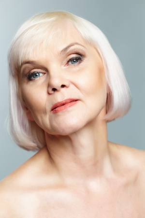 congenial: Portrait of aged female posing in front of camera
