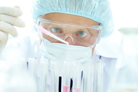 chemical substance: Portrait of a chemist making experiment with substance