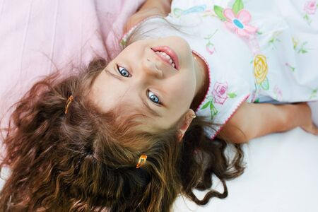 Above angle of lovely girl looking at camera with smile Stock Photo