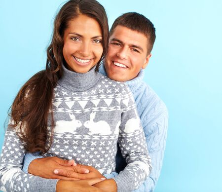 pullovers: Portrait of amorous couple in fashionable pullovers looking at camera with smiles