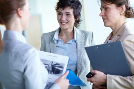 focus group: Image of confident businesswomen interacting at meeting