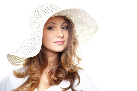 Young woman in hat posing in front of camera Stock Photo