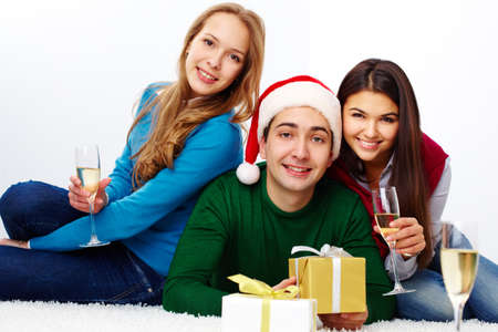 Image of teenage friends with champagne and gifts looking at camera Stock Photo - 16221825