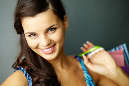 lifestyle shopping: Portrait of happy brunette with paperbags after shopping Stock Photo