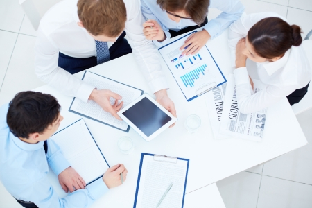 corporate meeting: Group of business partners interacting while planning work at meeting