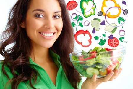 person appetizer: Close-up of pretty girl holding fresh vegetable salad in glass bowl