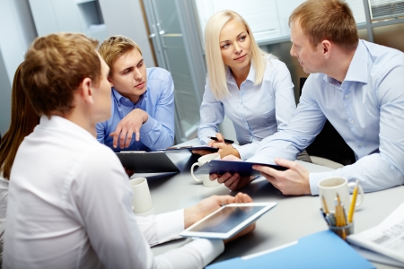 collaboration: Image of group of employees discussing new ideas or project at meeting