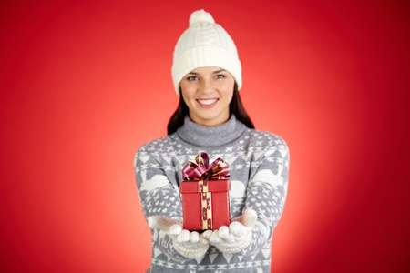 Portrait of happy girl with giftbox looking at camera Stock Photo - 16221828