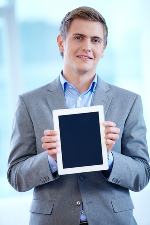 Portrait of cheerful businessman with touchpad looking at camera Stock Photo - 16333873