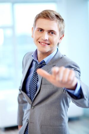 Portrait of cheerful businessman looking at camera while pointing at you Stock Photo - 16333931