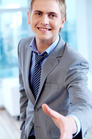 Portrait of cheerful businessman looking at camera ready for handshake Stock Photo - 16333926