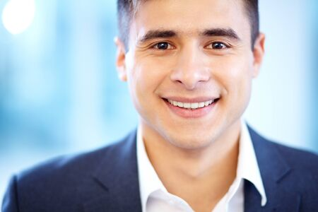 Face of cheerful businessman looking at camera with smile Stock Photo - 16333945