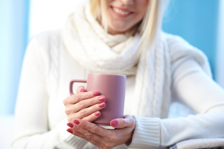 Photo of pink porcelain cup in female hands photo