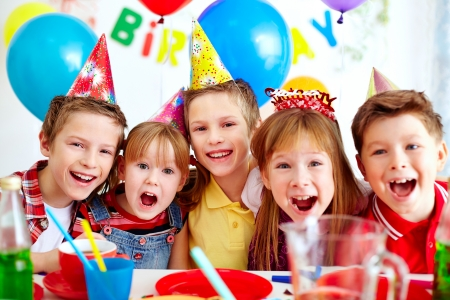 Group of adorable kids looking at camera at birthday party photo