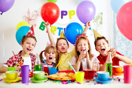 happy children: Group of adorable kids having fun at birthday party