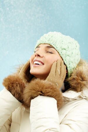 Portrait of delighted girl in winter clothes photo