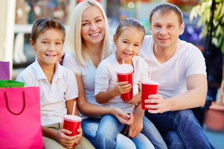 Portrait of joyful family having break and looking at camera in the mall Stock Photo - 16499285
